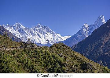 View of a Buddhist stupa with mountain Lhotse and Ama...
