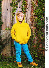 Outdoor portrait of adorable little 5 year old blond boy...