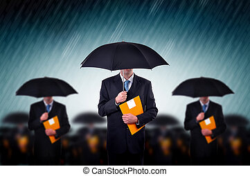 Businessmen in rain - Businessman with umbrellas in heavy...