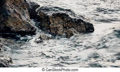 Sea waves breaking on the rocks - 4K UltraHD video of sea...