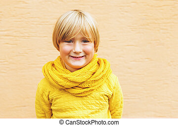Outdoor fashion portrait of adorable 5-6 year old little...