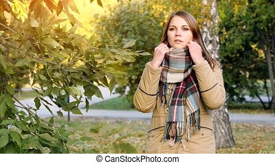 Portrait of an autumn smiling woman in scarf. 3840x2160 -...