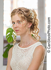 Young bride with beauty wedding hairstyle