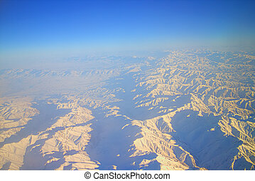 Flight over Pamir and Tien Shan 1. Air travel. Visible deep...