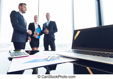 Business people and financial reports - Business people and...