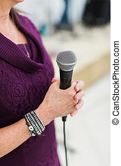 Woman signing live concert or speaking at conference live