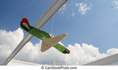 model aircraft on display hanging on against sky, close up