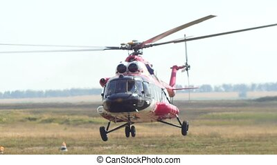 Modern emergency medicine helicopter take off at airfield,...