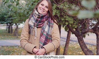 Portrait of an autumn smiling woman in scarf. - Portrait of...