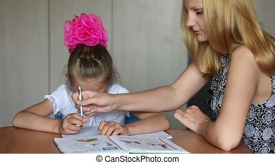Tutor girl shows how to do their homework