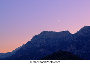 New moon over a mountains High dynamic range image tone...