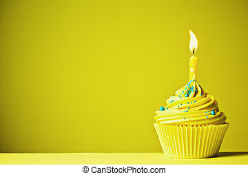 Yellow birthday cupcake - Cupcake decorated with a single...