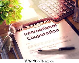 International Cooperation - Text on Clipboard. 3D. -...