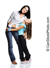 Mother with daughter isolated on white background. Studio...
