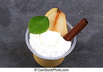 dessert of pears and cinnamon on a stone background