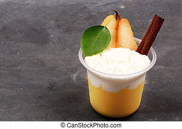 sweet dessert of pears and cinnamon on a stone background
