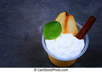pudding of pear and cinnamon on a stone background