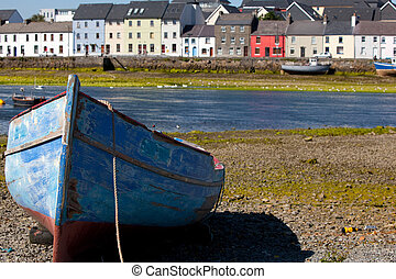 Blue Boat with the Houses in the Background - Old Blue Boat...