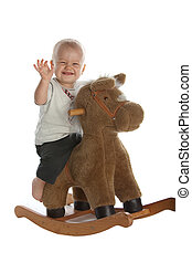 Cute Baby Boy on Rocking Horse - Little Smiling Baby Boy on...