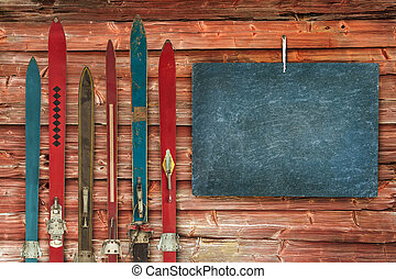 Collection of vintage wooden weathered ski's in front of an...