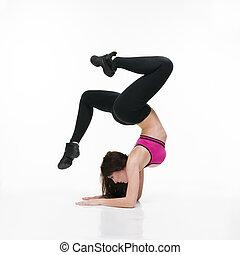 Young beautiful caucasian woman in yoga pose in studio on...