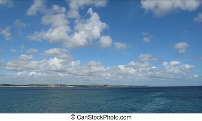 Time lapse clouds Mounts bay. - Time lapse white clouds over...