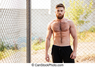 Handsome shirtless fitness man during workout outdoors -...
