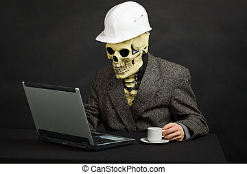 Comical man in helmet and skeleton mask with computer - The...