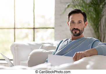 Handsome bearded man looking at you - Having a rest. Nice...