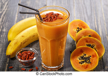 Papaya smoothie, selective focus. Detox, diet food,...