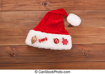 Santa hat Claus with toys on wooden background.