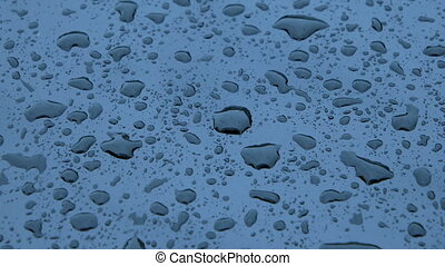 Rain drops on metal - Extreme Close up of Water drops on...