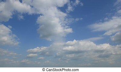 Time-lapse of beautiful white clouds moving over blue sky