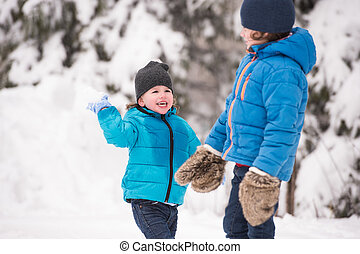Two cute boys playing outside in winter nature - Two cute...