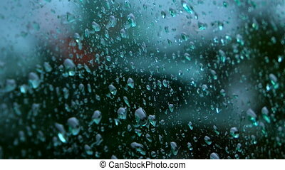 Close up of water drops running on glass - Rain drops...
