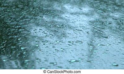 Rain Falling On Car Windscreen - Close up of water drops...