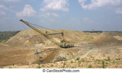 The excavator works in a quarry