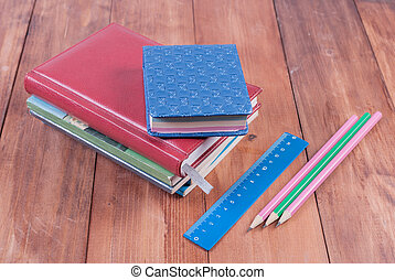 School supplies on a wooden background. Back to school. -...