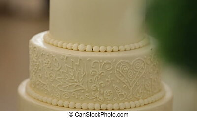 Big tiered wedding cake decorated wedding, selective focus -...