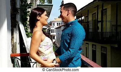 Young couple in love outdoor in the balcony