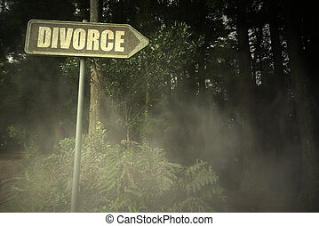 old signboard with text divorce near the sinister forest -...