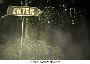 old signboard with text enter near the sinister forest