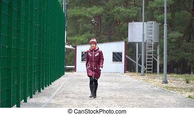 Woman running at the camera