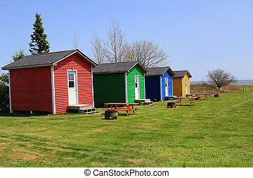 colorful shacks with picnic tables - Colorful one room...
