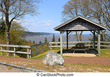 Picnic table with view on the Fundy Trail Parkway -...