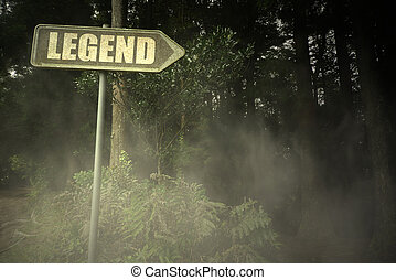 old signboard with text legend near the sinister forest -...