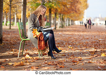Girl reading a book in park