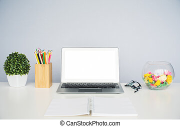 Desktop with white laptop - Front view of creative designer...