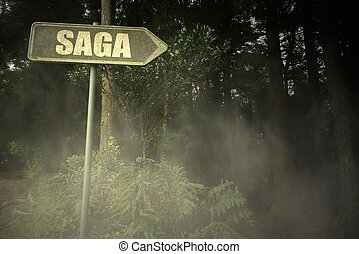 old signboard with text saga near the sinister forest -...