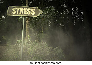 old signboard with text stress near the sinister forest -...